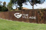 The village Entry Wall Sign